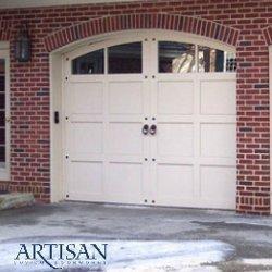 A raised panel wood garage door.