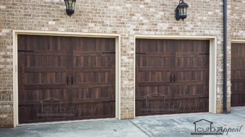 Steel Carraige doors with wood grain finish. Duluth, GA