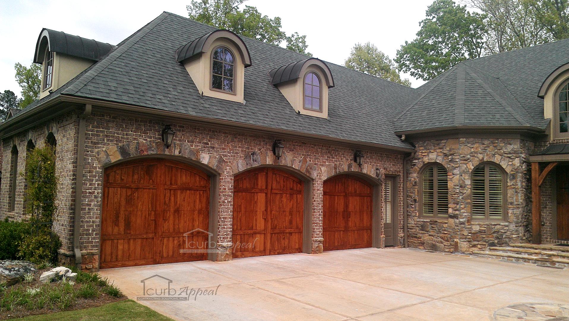 3 Cypress wood garage doors.