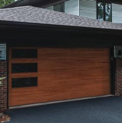 A modern wood garage door in a flush panel design.